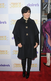 Kris Jenner stepped into a pair of black patent leather ankle boots for the premiere of 'Mirror Mirror.'