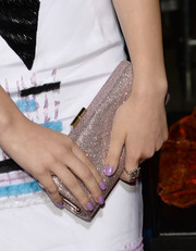 Hailee Steinfeld attended the premiere of 'Romeo and Juliet carrying a glamorous silver clutch.