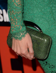 Nathalie Rapti Gomez sported an all-green hard-case clutch and lace dress combo at the premiere of 'Romeo and Juliet.'