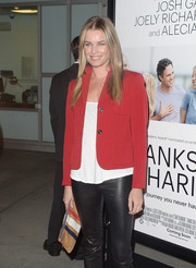 Rebecca Romijn teamed a red cropped blazer with black leather skinnies for a fierce finish at the 'Thanks for Sharing' premiere.