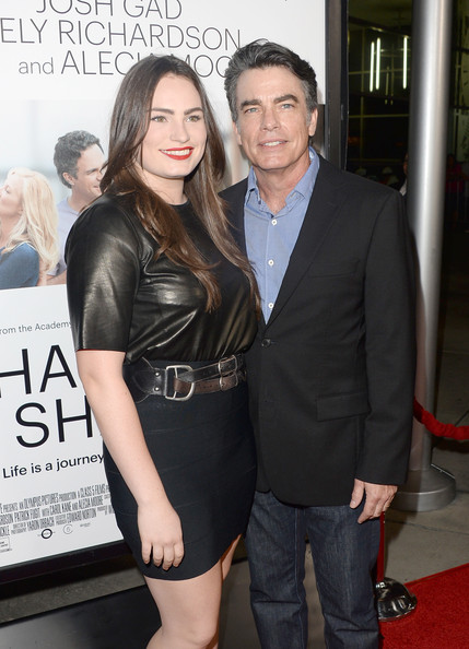 Kathryn Gallagher paired a black leather top with a tight mini for a sexy-edgy look during the 'Thanks for Sharing' premiere.