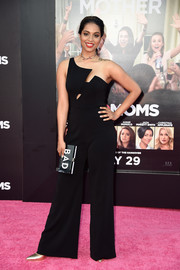 Lilly Singh cut a sleek silhouette in her Jay Godfrey Black Blair asymmetric jumpsuit that she paired with a Milly Good/Bad Box Clutch at the 'Bad Moms' premiere.