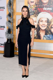 Mila Kunis was festive and sexy in a fitted cold-shoulder LBD by Cushnie et Ochs, featuring a tinsel-embellished neckline and a high side slit, at the premiere of 'A Bad Moms Christmas.'