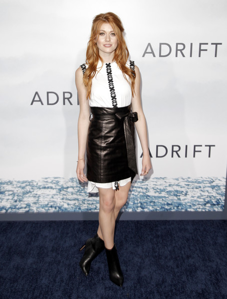 Katherine McNamara tied her look together with a pair of black ankle boots by BCBGMAXAZRIA.