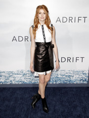 Katherine McNamara layered a black leather MILLY PF18  mini skirt over her dress for an edgy finish.