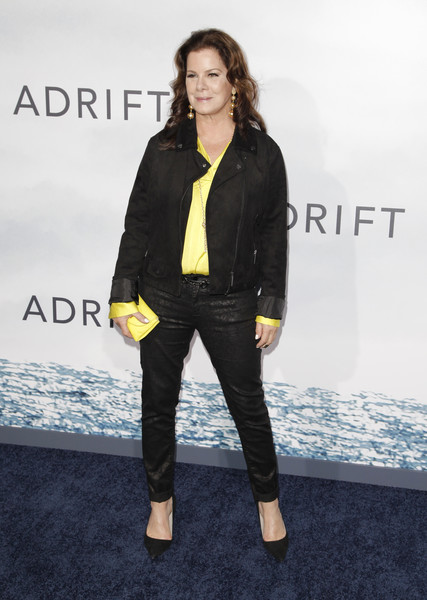 Marcia Gay Harden layered a black suede biker jacket over a yellow shirt for the premiere of 'Adrift.'