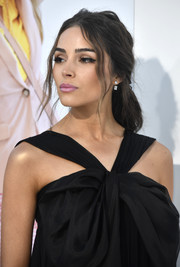 Olivia Culpo styled her hair into a messy-glam half-up 'do for the premiere of 'I Feel Pretty.'