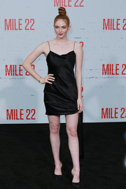 Larsen Thompson attended the premiere of 'Mile 22' looking seductive in a little black slip dress.