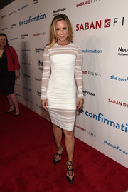 Maria Bello looked ageless in a ruched white sheer-overlay dress at the premiere of 'The Confirmation.'