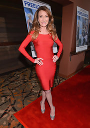 Jane Seymour showed off her impossibly fit figure in this long-sleeve red bandage dress.