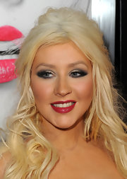 Christina Aguilera paired her sultry smoky eye with red hot saturated lips. While we prefer to rock one look at a time, Christina somehow pulls this dramatic look off.
