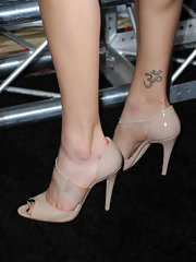These cutout nude heels are very chic and are a nice color for her dress.