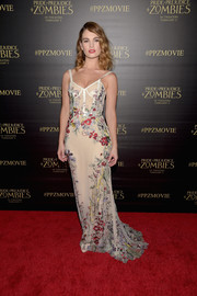 Lily James went for boudoir glamour in a floral-embroidered corset gown by Alexander McQueen at the premiere of 'Pride and Prejudice and Zombies.'