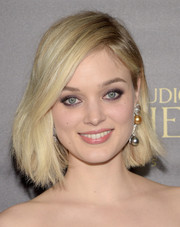 Bella Heathcote polished off her look with a pair of dangling pearl earrings.