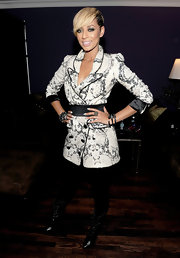 Keri paired her lace up boots with a snakeskin print trench coat.