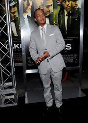 T.I. opted for a silver tie to complement his grey suit.