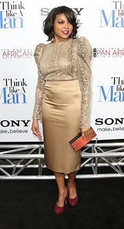 Taraji P. Henson wore a strong-shouldered snakeskin blouse to the 'Think Like a Man' premiere.