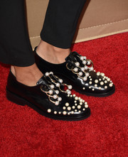 Kat Graham rocked a pair of Coliac 'Martina' black loafers, which were embellished with gold rings and pearls, at the premiere of 'American Horror Story: Hotel.'