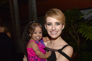 Actresses Jyoti Amge (L) and Emma Roberts pose at the after party for the premiere screening of FX's 'American Horror Story: Freak Show' at the Roosevelt Hotel on October 5, 2014 in Los Angeles, California.
