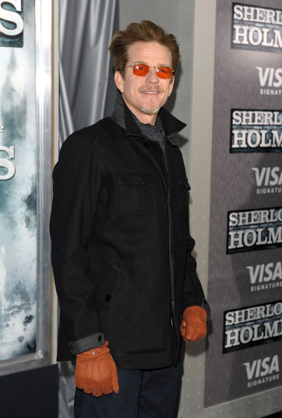 """Matthew Modine matched his citrus hued sunglasses to orange gloves at the premiere of """"Sherlock Holmes."""""""