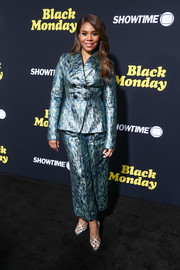 Regina Hall looked radiant in a metallic blue pantsuit by Claudia Li at the premiere of 'Black Monday.'