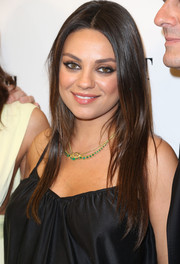 Mila Kunis opted for simple center-parted layers when she attended the 'Third Person' premiere.