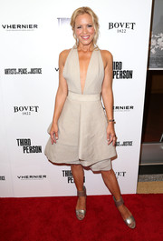 Maria Bello added shine to her outfit with a pair of silver ankle-cuff sandals.