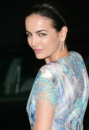 Camilla Belle showcased sleek long diamond earrings at the premiere of '2012.'