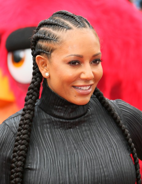Melanie Brown attended the premiere of 'Angry Birds' wearing her hair in cornrow braids.