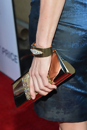 Kim Dickens added some hardware to her red carpet look with this metallic gold clutch.
