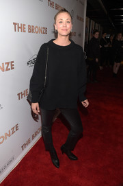 Kaley Cuoco complemented her sweater with cropped black leather pants.
