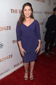 Mayim Bialik went classic in a purple faux-wrap dress for the premiere of 'The Bronze.'