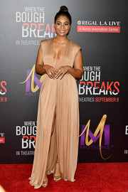 Regina Hall oozed sexy glamour in a nude Elisabetta Franchi gown with a navel-grazing plunge and a high front slit during the premiere of 'When the Bough Breaks.'