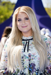 Meghan Trainor wore her long tresses down with a side part when she attended the premiere of 'Smurfs: The Lost Village.'