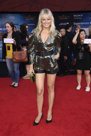 Malin Akerman kept it relaxed yet glam in a gold sequined romper by Simona Corsellini at the premiere of 'Spider-Man: Far From Home.'