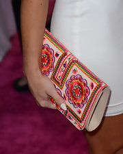 Cara Santana added some color and texture to her all-white look with this floral embroidered clutch.