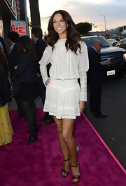 Terri Seymour opted for a more elegant and ethereal look at the 'Spring Breakers' premiere when she chose this long-sleeved white frock.