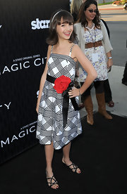 Taylor Blackwell was a doll at the 'Magic City' premiere in this rose-adorned plaid dress.
