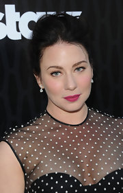 Lynn Collins attended the premiere of 'Magic City' wearing matte fuchsia lipstick