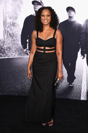Garcelle Beauvais went for bondage glamour at the 'Straight Outta Compton' premiere in a black Aidan by Aidan Mattox gown with a strappy midriff cutout.