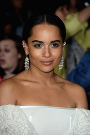 Zoe Kravitz topped off her ensemble with a pair of glamorous diamond chandelier earrings by Martin Katz.
