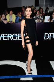 Maggie Q looked dangerously sexy at the 'Divergent' premiere in a one-sleeve Anthony Vaccarello LBD with sultry side cutouts and studded detailing.