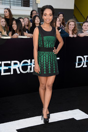 Lyndie Greenwood put her legs on show in a super-short green and black geometric-patterned dress during the 'Divergent' premiere.