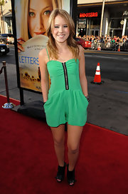 "Actress Taylor Spreitler showed off her green romper while attending the ""Letters To Juliet"" premiere in Hollywood."