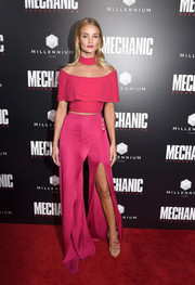 Rosie Huntington-Whiteley was trendy and girly in a fuchsia off-the-shoulder crop-top by Balmain at the premiere of 'Mechanic: Resurrection.'