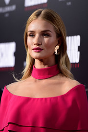 Rosie Huntington-Whiteley coated her famous pout a raspberry hue to match her outfit.