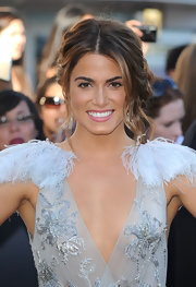 Nikki wore a chic, messy updo with face-framing waves and a tousled side bun.
