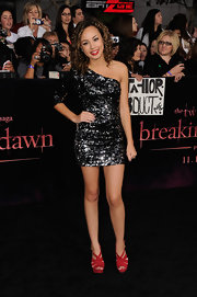 Savannah Jayde sparkled on the runway in a one-shoulder sequined frock paired with fiery red platform sandals.