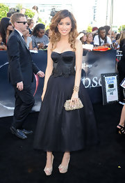 Christian paired her bustier black dress with the hot Clou Noeud studded pumps.