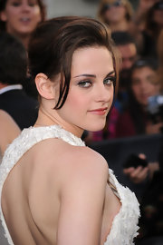 Kristen continued the shock-fest when she opted for a sweet updo, instead of her usual layered, tousled style.